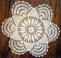 This is a vintage 12.5 inch doily. I think it would make a lovely child's blanket in a thicker yarn.