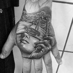Gentleman With Lady Justice Hand Tattoo