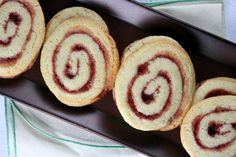 Recipe for Linzer Pinwheel Cookies- a lemon scented, raspberry swirl cookie. Festive recipe for Christmas or Valentine's Day.