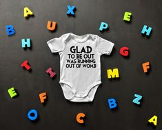 8b692e936 Glad To Be Out Was Running Out Of Womb - One Piece Bodysuit. Gerber OnesiesRomper  SuitBella CanvasNew Baby ...