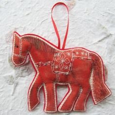 Starting to think about new designs for Christmas, a handstitched horse decoration