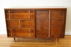 Mid century modern credenza with sliding doors and vertical brass tipped handles