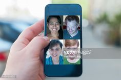 Four friends meeting online, displayed on phone