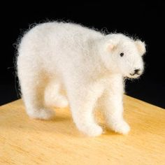 WoolPets Polar Bear needlefelting kit. Learn the art of sculptural needle felting! Kit includes felting needles, wool roving, and step by step photo instructions that make this craft a snap. Kit makes