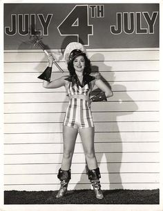 Stars and strips abound on actress Ann Rutherford's festive 4th of July ensemble.