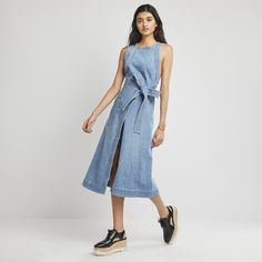 This denim wrap dress is supercool and subtly sexy all on its own, but it's also a perfect layering piece—just add a blouse underneath. Styled here with...