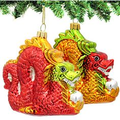"Orange & Red Dragon Ornaments - Glass      Celebrate the holidays with our colorful and unique dragon glass ornaments.  Choose from either a red or orange dragon, complete with glittered scales and a detailed face.  Measures 3.5"" Tall x 3.75"" Wide  http://www.nycwebstore.com/detail.aspx?Product_ID=KA-D0487"