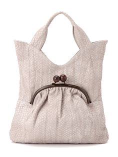 I did not pin this bag because it is cute. I don't even think it's cute. All I see is an unmistakable frowny face haha