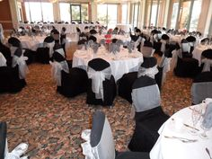 Black Chair Covers available for rent with Silver Organza Bows in Azusa  - Special Event Linens