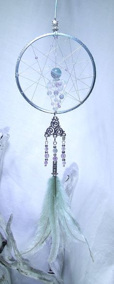 Check out this item in my Etsy shop https://www.etsy.com/uk/listing/270227692/rainbow-fluorite-dream-catcher-wall