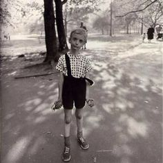 Diane Arbus' photograph which shows that a child in the park with a hand- bomb and a toy.