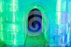 Tunnel made from ice with green and blue lights inside