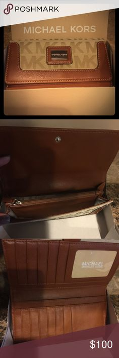 NWOT Michael Kors Wallet Michael Kors Signature leather wallet- new without tags. Comes with box but I don't have the tags because it was a gift. See my closet for matching purse. Michael Kors Bags Wallets
