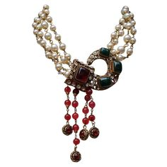 1984 Chanel necklace with Faux Pearls and Red and Green Glass Paste   From a unique collection of vintage multi-strand necklaces at https://www.1stdibs.com/jewelry/necklaces/multi-strand-necklaces/