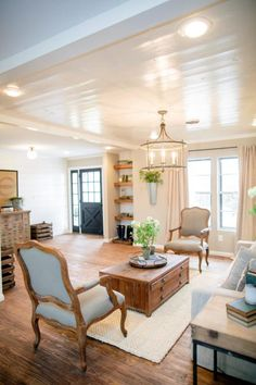 Bright white paint adds a modern touch atop the pine ceiling, and reflects light around the open living room.