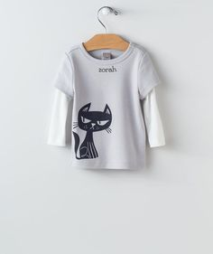 "Your baby boy will wonder, ""What's that black cat up to?"" This mock layered tee…"