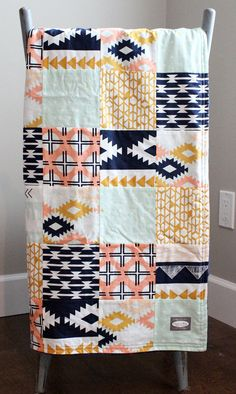 The fabric!!  Patchwork Baby Blanket Navy Peach Mint and Gold by GiggleSixBaby