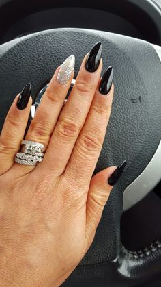 Black & glitter stilleto biosculpture nails by mel at danielles beauty salon ferntree gully Natural nail no overlay Vintage diamond rings Engagement ring Wedding band @jessboros