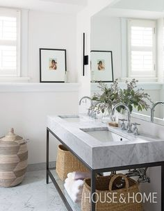 In this second-floor principal bath, a trough-style vanity by RH Restoration Hardware with a clean-lined marble top is classic and timeless. | Photographer: Alex Lukey | Designer: Sam Sacks