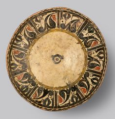 """Slip Painted Calligraphic Bowl - ADC.168 Origin: Central Asia Circa: 10 th Century AD to 11 th Century AD  Dimensions: 3.35"""" (8.5cm) high x 13.23"""" (33.6cm) wide  Collection: Islamic Art Medium: Earthenware"""