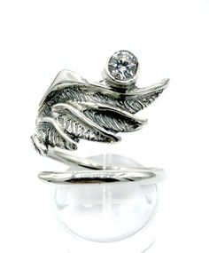 Angel Wing Ring, silver wing ring, angel ring, wing ring, handmade angel wing ring with gemstone. birthstone angel ring one size fits all adjustable ring handmade wing ring. Angel ring designed by Eleni Pantagis contact us about gemstone replacement. Chunky Silver Rings, Mens Silver Rings, Sterling Silver Cross Pendant, Sterling Silver Rings, Angel Wing Ring, Mens Band Rings, Sunflower Jewelry, Wholesale Silver Jewelry, Engraved Jewelry