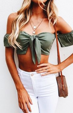 Light green top paired with white jeans. Cute for vacation in a tropical area.