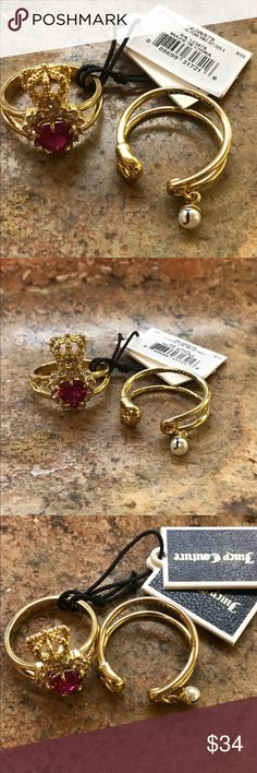 Juicy Couture punk ring. Ruby red crown The Royal Punk Ring Set features two edgy and stylish gold-tone rings. A wrapped safety pin is accented with a faux pearl charm while a heart-shaped colored stone topped with our iconic crown motif highlights the second ring.  Two ring set. Metal, faux pearl and crystal details. Imported  Size:8  Retail $68 Juicy Couture Jewelry Rings