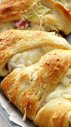 Cordon Bleu Crescent Ring ~ Flaky Crescent Rolls Stuffed with Swiss Cheese, Ham, Chicken and Topped with Garlic Butter.. Quick & Easy Dinner!