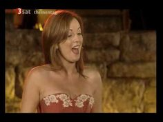 """""""THE VOICE"""" by Lisa Kelly and featuring Mairead Nesbitt on fiddle.  From Celtic Woman concert at Slane Castle in Ireland."""