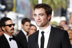Could he be any more sexy?  Nope!  I don't think so!  Ahhhh, my pic for Mr. Grey.    Festival de Cannes 2012 : Robert Pattinson