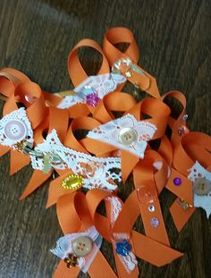 These are the orange ribbons which we made to wear in honour of Orange Day. Apart from the orange ribbon, the embellishments were recycled bits and pieces which emphasize the feminine.  Our Social Justice Committee reminds you that the United Nations has proclaimed the 25th of each month, Orange Day, when we call for the eradication of violence against women without reservation, equivocation or delay.