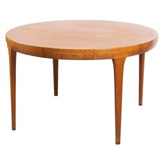 Ib Kofod Larsen - Dining Table In Teak | From a unique collection of antique and modern dining room tables at http://www.1stdibs.com/furniture/tables/dining-room-tables/