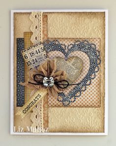 by Liz Munoz - Liz's Paper Loft.  Papers: Teresa Collins Vintage Finds, PTI cardstocks. My Creative Time:  Stitched Scallop  Heart Die, Chocolate Greeting Stamp/die set. Inks: Tim Holtz.  Extras: Seam Binding Ribbon, Thin Black Hemp, Square Faceted Button, Ecru Crochet Lace.  Cuttlebug Embossing Folder ~ Teresa Collins