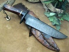 "T""Chupacabra Hunter""- This piece is a beast, so I named it after one. This hunter/camp chopper has a differentially quenched blade of 5160 high carbon spring steel with forge marked and acid soaked flats with my ""antiqued"" finish on the flat ground bevels. The knife has an oval carbon steel guard with a fullered rim and matching finish. The handle is dyed & sealed Cow bone with a throat of stabilized Buffalo horn and a spacer of hammered/antiqued brass..."