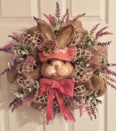 Easter Wreath, Burlap Deco Mesh,Deco Mesh, Natural Bunny Face, Bunny Head, Pink Burlap, pink Purple white flowers, Rabbit Head, Wreaths by RoesWreaths on Etsy https://www.etsy.com/listing/224075081/easter-wreath-burlap-deco-meshdeco-mesh