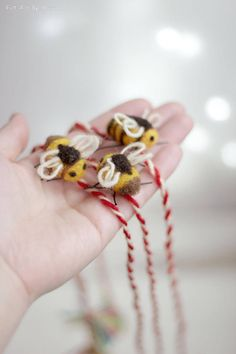 Set of three Martenitsa bracelet with small Needle Felt Bee. Colors: Red and White, Brown, Yellow and Colorful Ends. *If you prefer it in a different color or merely wish to order more/less of them you may contact me.   History:  Martenitsa (Bulgarian: мартеница,) is a small piece of