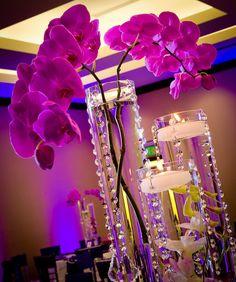 centrepieces. glass vases. purple.