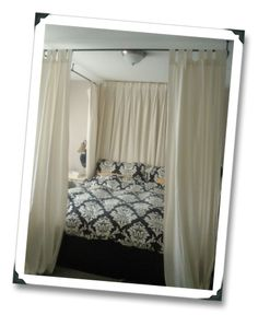 I love the canopy style beds, but our room is too small for one. This might actually help create division between the sleeping area and the office area of the already small room:D)