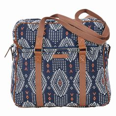Cora Wanderlust ToteThe Bella Taylor Cora Wanderlust Tote features an overscaled diamond jacquard pattern that has been given a fresh update in navy and crème with coral accents. Brown leather trim, antique pewter hardware. Solid navy cotton lining.