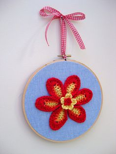 Crochet flower picture (I don't like the ribbon choice though). ~ make smaller, in sets of 3, hang vertically.