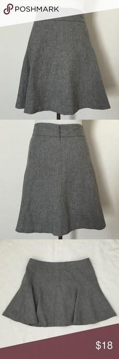 Banana Republic Flannel Ponte Skirt Banana Republic Fit and Flare skirts. Back zip with a hook closing. Lined. Very Slimming. Great with tights, boots, or heels. 40% Wool. 30% Polyester. 29% Viscose. 1% Spandex. Length is 18in. Banana Republic Skirts