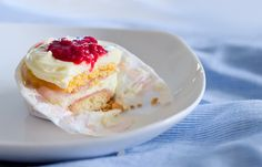 Layered Lime Biscuit, White Chocolate Mousse with Lime Zest and Peach Puree and Raspberry Sauce!  This sounds so good!