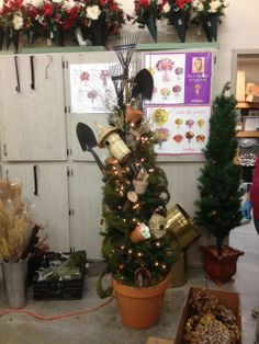 This tree is currently in progress, but here's a sneak peek at some of the AWESOME decorating ideas that come from our very own, Gail Hillermann.