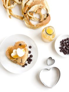 Chocolate Chip Heart Pancakes are the perfect match for Valentine's Day breakfast or brunch! It doesn't get sweeter than this recipe! | www.chicandsugar.com