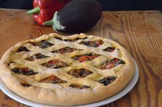 La Crostata Salata di Peperoni e Melanzane è una torta salata molto saporita, con un ripieno ricco di verdure estive che conquista tutti.