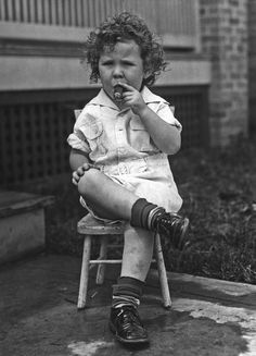 Cigar-smoking child, Washington DC, 1928