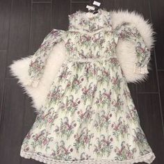 I just added this to my closet on Poshmark: Topshop open shoulder floral dress.Topshop floral. Price: $66 Size: 8