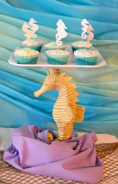 beach theme party fun cupcakes at a little mermaid girl birthday party see more party ideas at catchmyparty
