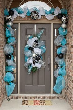 black and teal deco mesh doorway garland and door decoration pinning this could be done in any colors!!