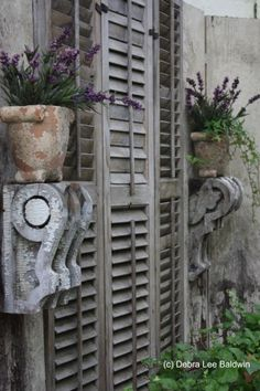 Lani Freymiller's garden, old shutters and corbels with plant accents. I'd pack a row of shutters against the wall and hang all my plants from them. Garden Art, Garden Design, Home And Garden, Garden Walls, Garden Canopy, Balcony Garden, Outdoor Rooms, Outdoor Gardens, Outdoor Decor